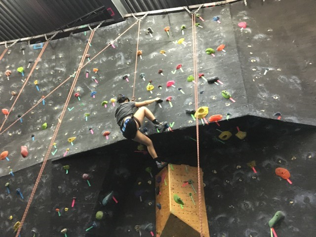 Another CAN Lab student climbing a different rock wall