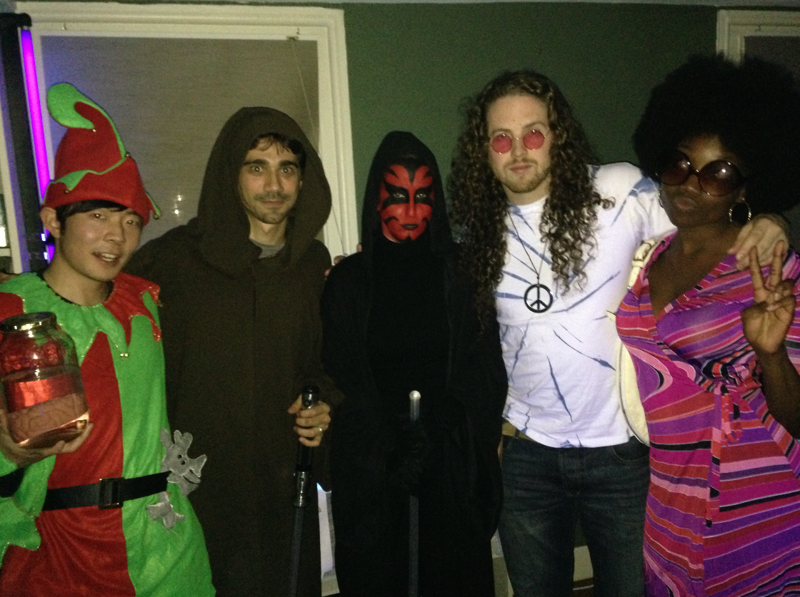 A Christmas elf, The Emperor and Darth Maul from Star Wars, and two Hippies