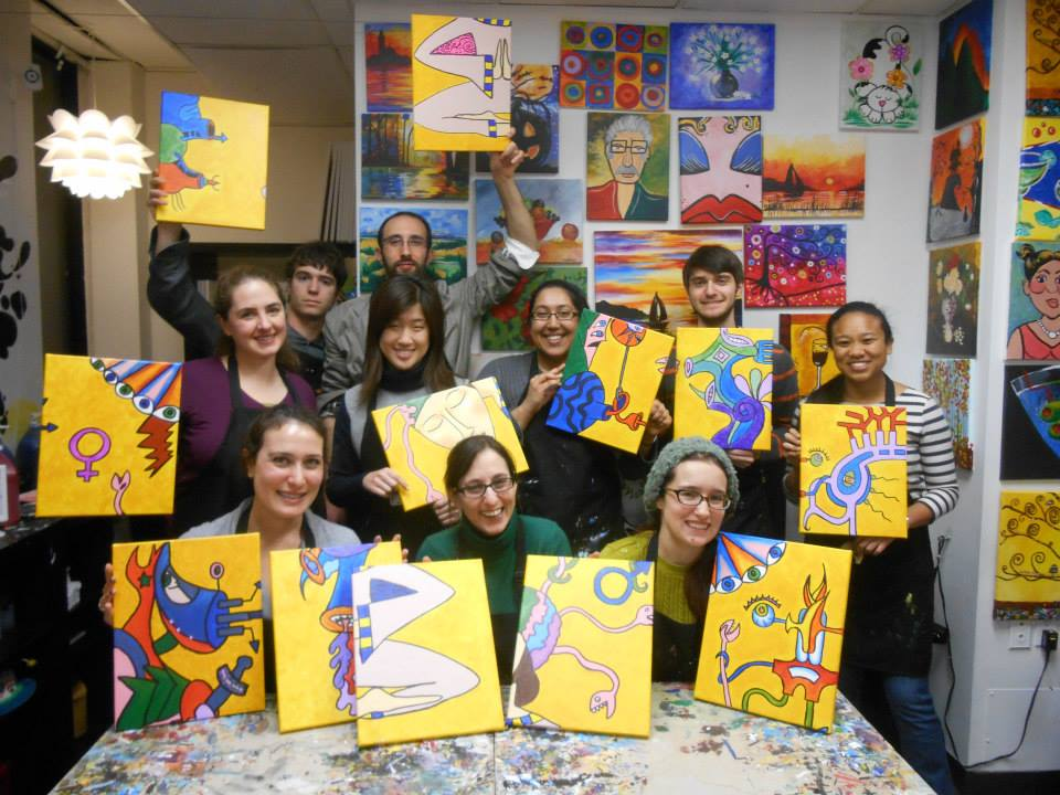 A group photo of the CAN Lab members with their finished paintings