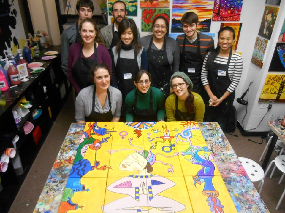 The members of CAN Lab, with their finished paintings connected to form a single picture